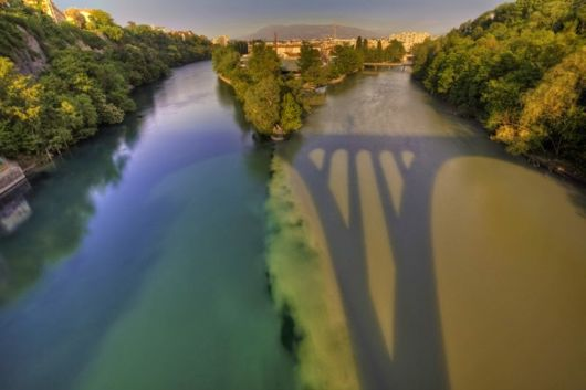 The Meeting Of Rhone And Arve Rivers In Switzerland