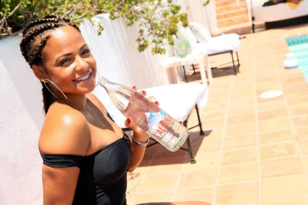 Christina Milian Attends Pool Party In Malibu